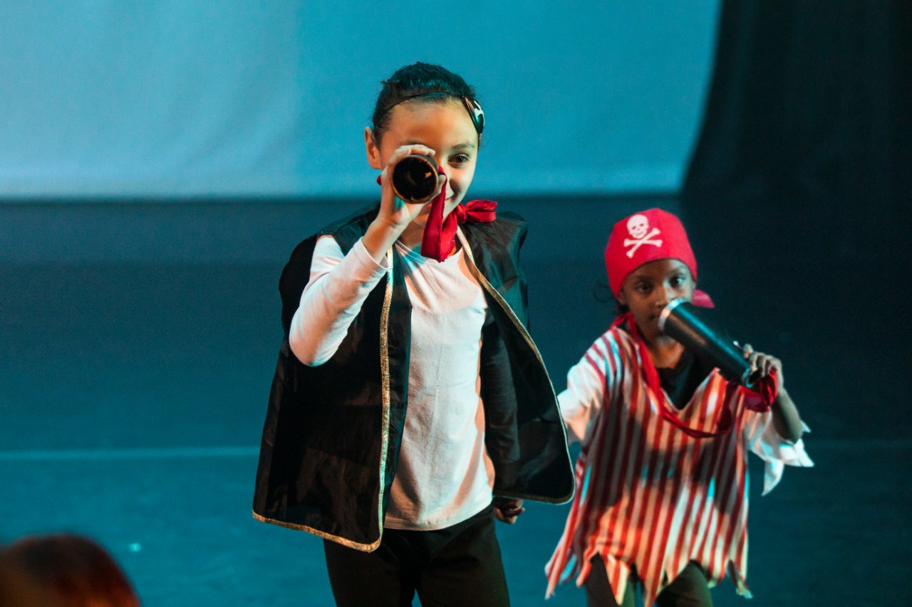 girl and boy dressed as pirates on stage dancing