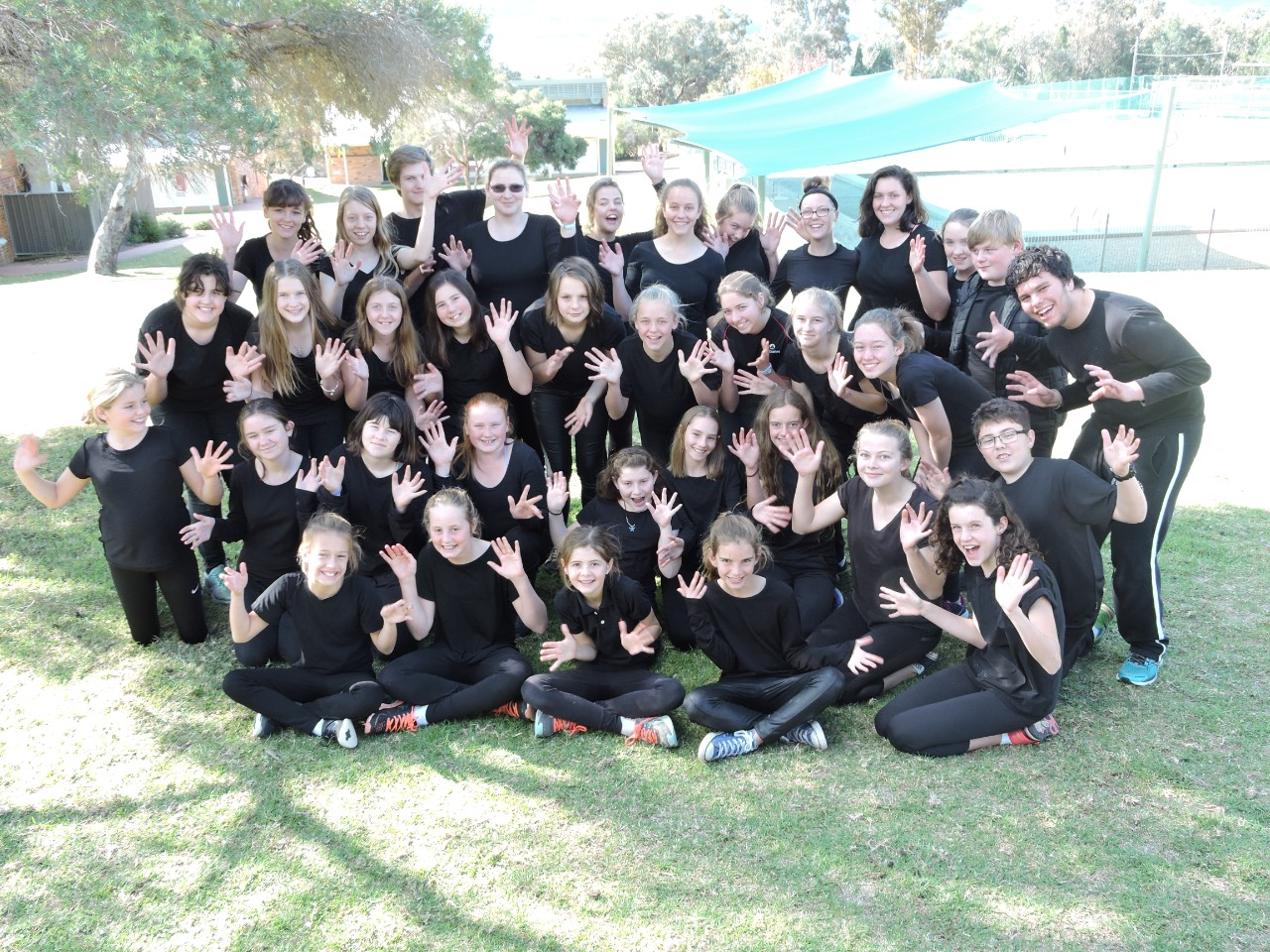 large group of drama students in black camp tshirts