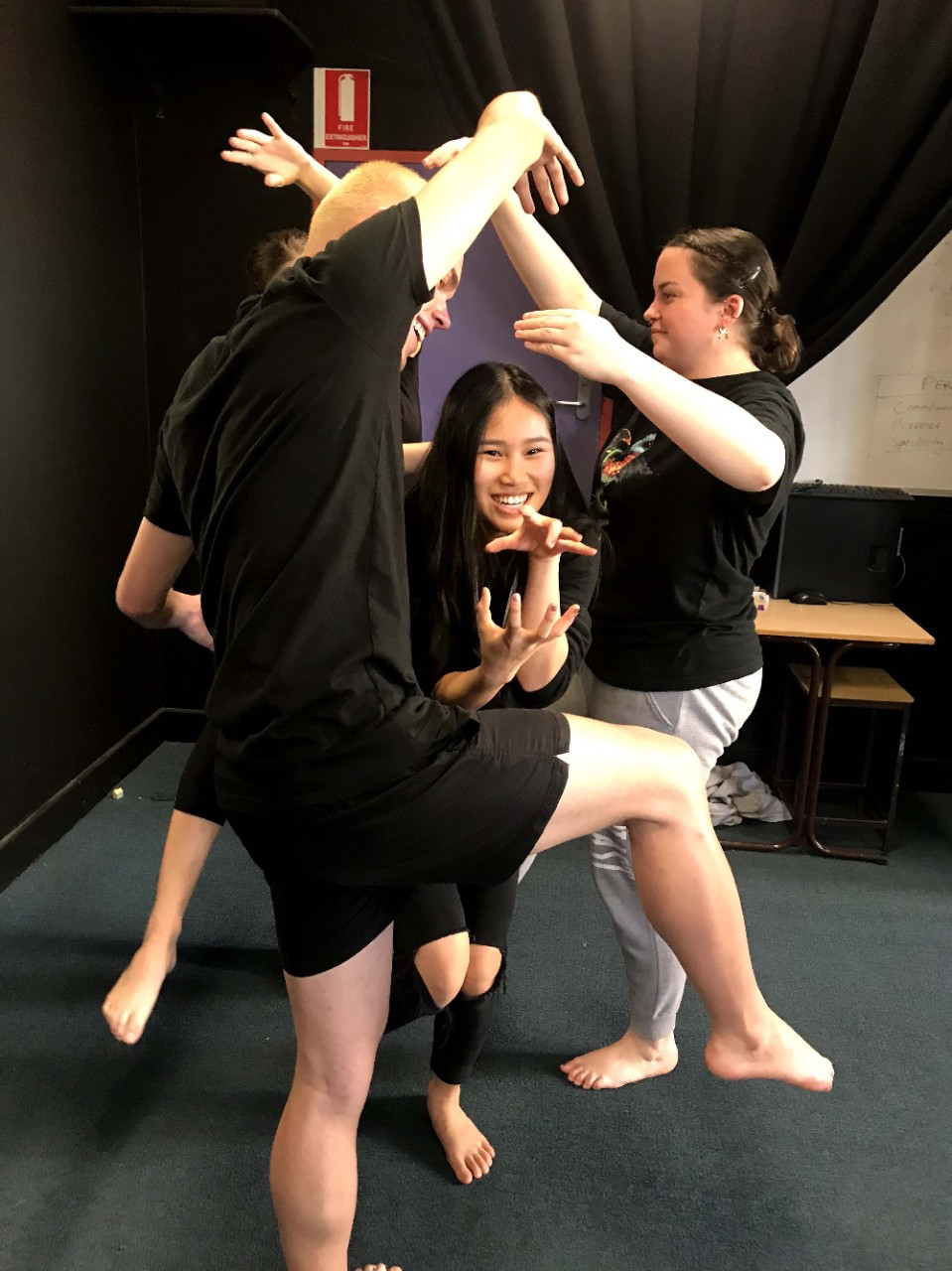3 students working together to create a static pose